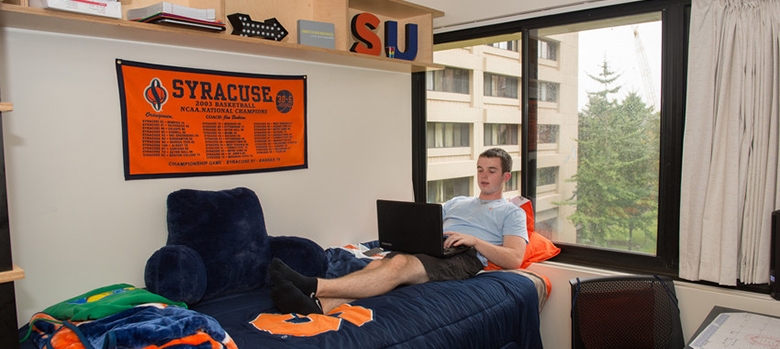dorm room with reclining student